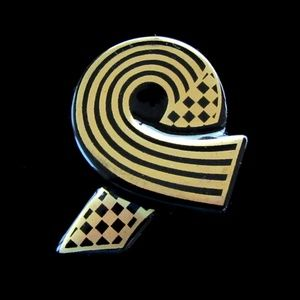 Black & gold modernist china ribbon brooch signed